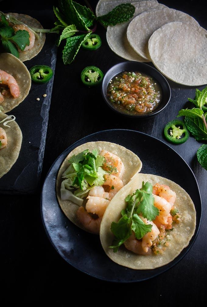2 vietnamese shrimp street tacos with salsa and jalapenos and cilantrol