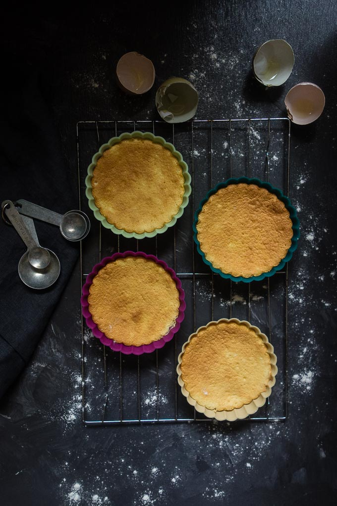 vietnamese sponge cakes in tart dish on baking rack