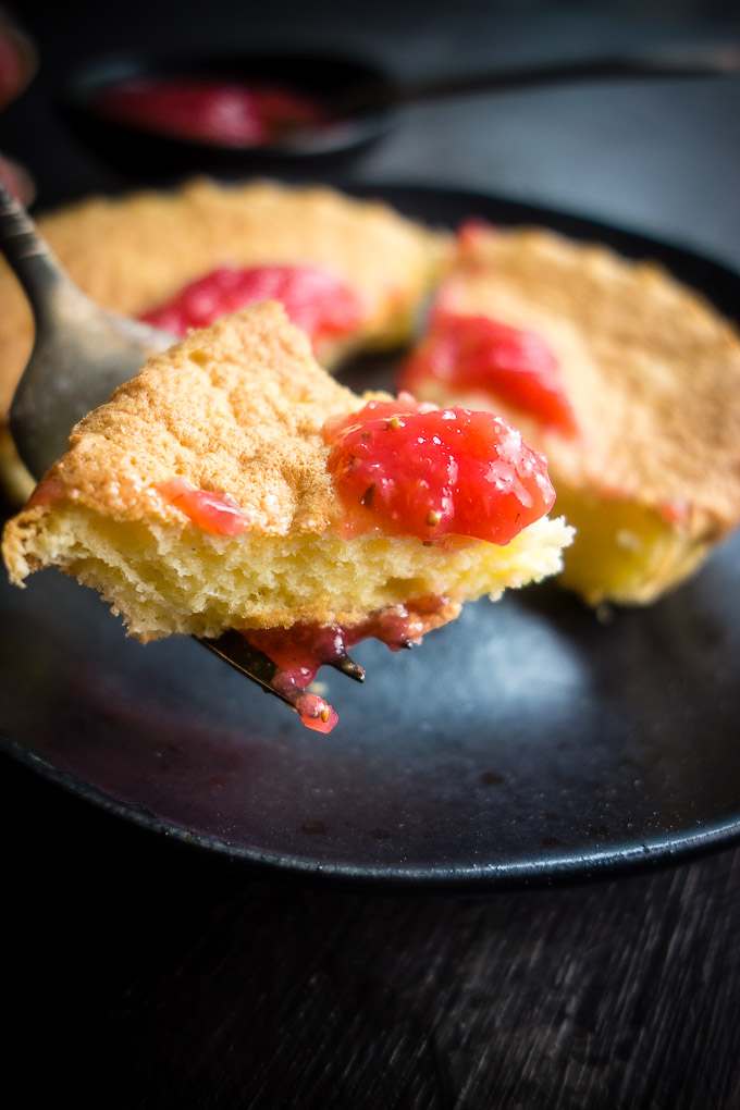 fork of vietnamese sponge cake with strawberry sauce