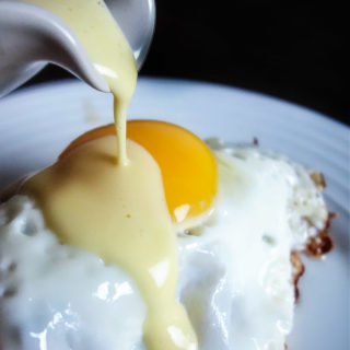 5 minute blender hollandaise poured over an egg
