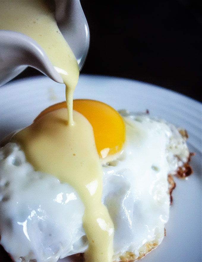5 minute blender hollandaise sauce poured over an egg