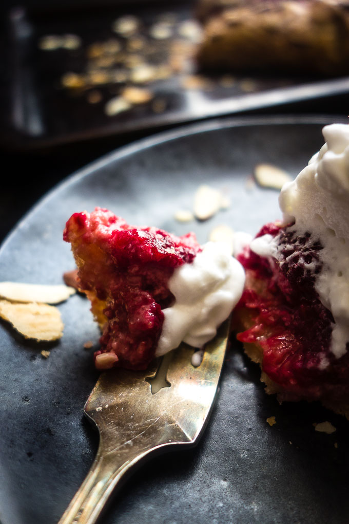 fork of almond raspberry galette with whipped cream