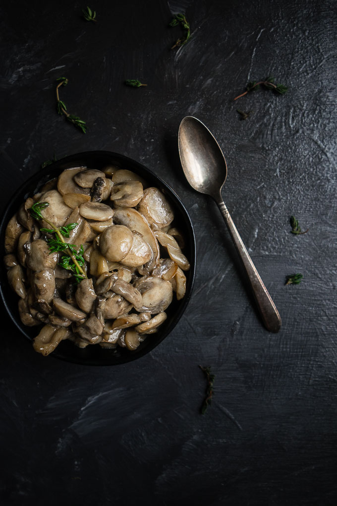 bowl of mushrooms with a spoon