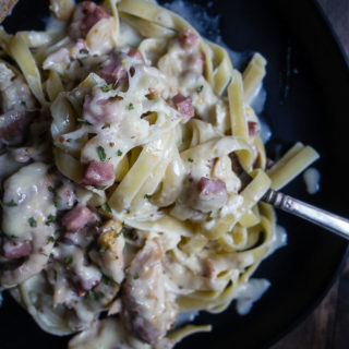 creamy sauce with ham and chicken over fettuccine