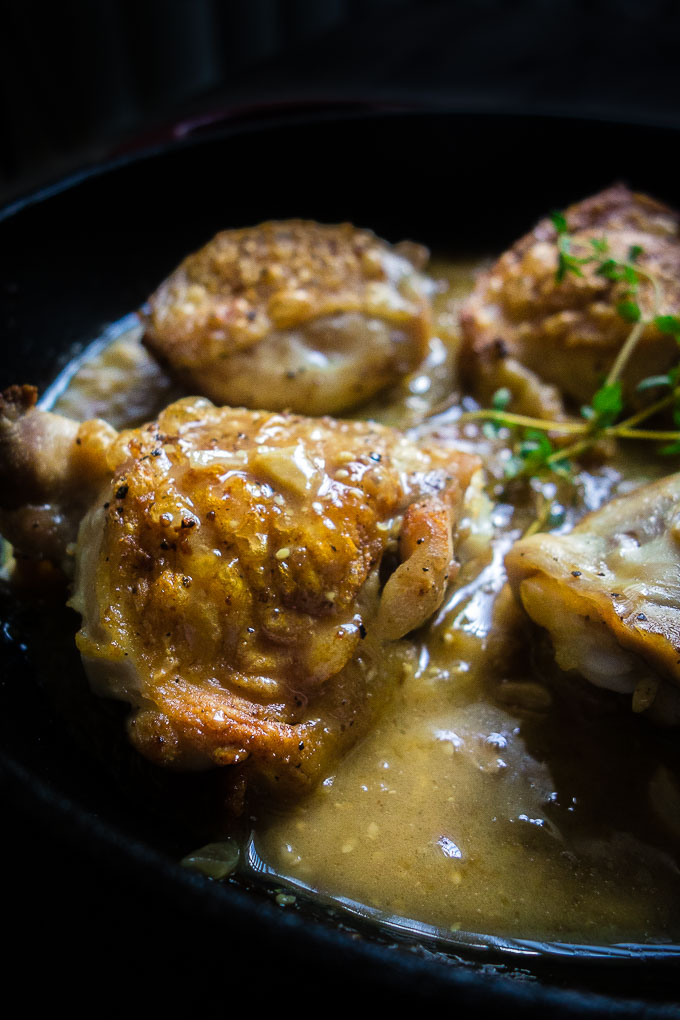 close up of creamy french dijon chicken thigh