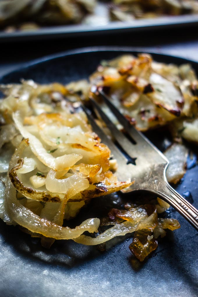 crispy potatoes and onions on plate with fork