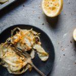 plate of crispy potatoes and onions on a plate with lemon