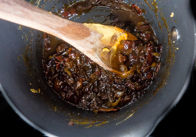 caramelized homemade bacon jam stirred in a saucepan
