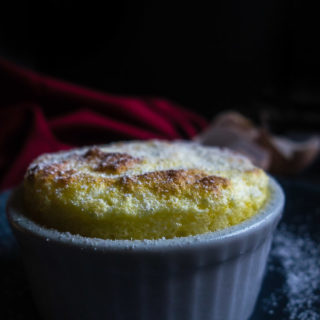 close up of meyer lemon souffle from side in dish