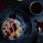 meyer lemon souffle drizzled with raspberry (red) sauce