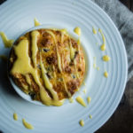 souffle drizzled in yellow sauce (hollandaise)