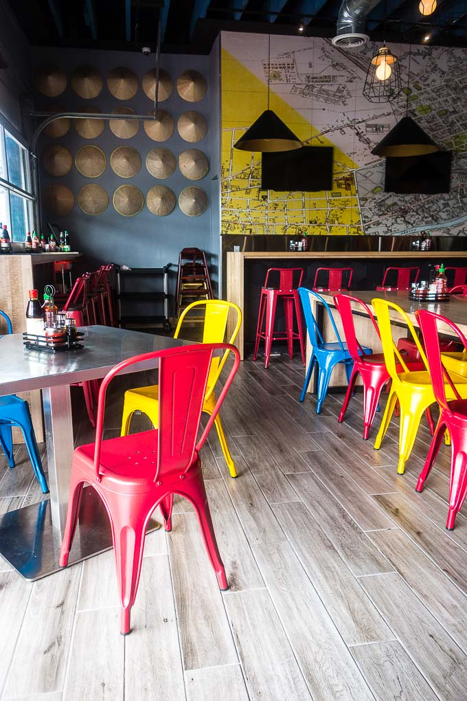 inside restaurant with red blue and yellow chairs