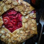 rustic strawberry galette with almonds and fork