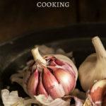 fresh bulbs of garlic halfway peeled on a plate