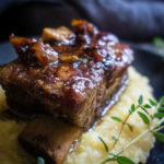 close up of white wine braises short rib