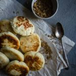 sweet korean pancakes on parchment paper with spoon and walnuts