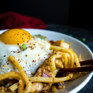 noodles topped with fresh egg