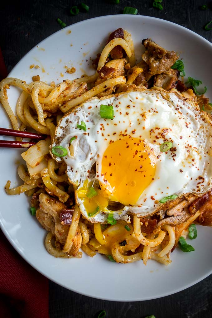 broken egg yolk over udon noodles and chicken