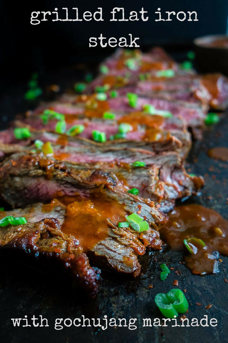 This Korean BBQ flat iron steak is marinated in the most amazing gochujang marinade and grilled to mouthwatering perfection. It's the perfect dish for summer grilling!spicy korean steak | korean marinade | grilling recipes | grilled beef | korean BBQ | how to cook flat iron steak | perfect seared beef | grilled flat iron steak | spicy marinated flat iron steak | best steak recipes