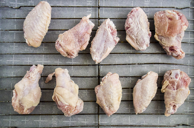 raw chicken wings on baking sheet