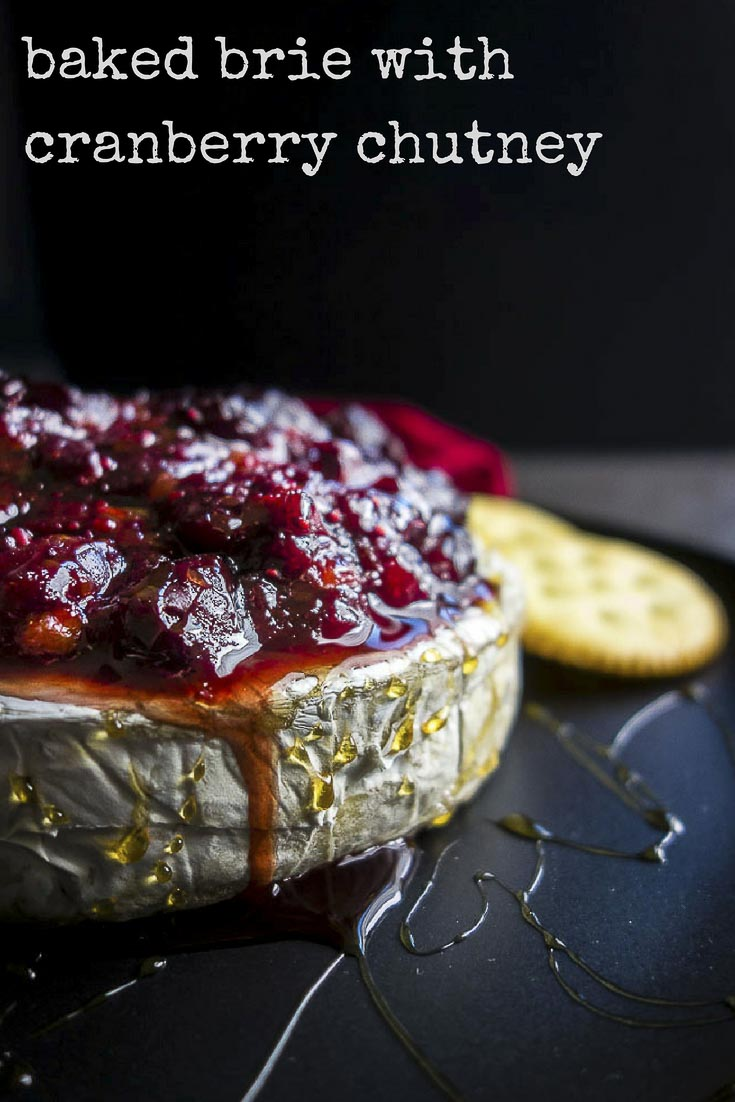 This rich, ooey, gooey, warm easy baked brie with homemade cranberry chutney is the perfect appetizer for that holiday party (or to eat alone...). #bakedbrie #holidayrecipes #cranberrysauce easy thanksgiving appetizers | cranberry recipes | homemade chutney | cranberry orange chutney | oven baked brie | simple baked brie | cranberry ginger orange chutney | cranberry baked brie | brie appetizers | holiday brie | holiday recipes | 15 minute baked brie | warm brie cheese
