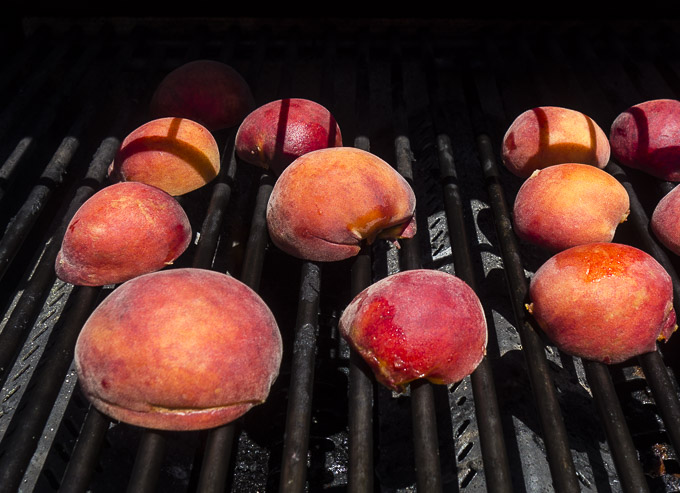 peach halves on a grill