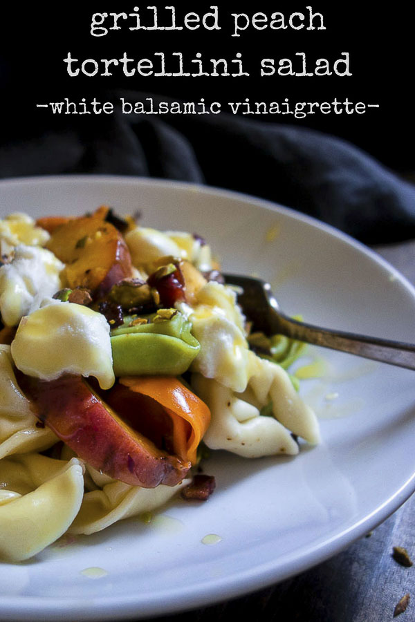 The Grilled Peach Tortellini Salad is made with fresh summer peaches, crispy fried pancetta, pistachios, white balsamic vinaigrette and ricotta cheese and is the BEST SALAD EVER! You'll want to eat this every day.grilled peaches | peach pasta salad | summer fruit salad | tortellini salad | white balsamic vinaigrette | peach and pancetta pasta salad | peach and ricotta | homemade vinaigrette | best peach salad | grilled peach salad | grapefruit vinaigrette