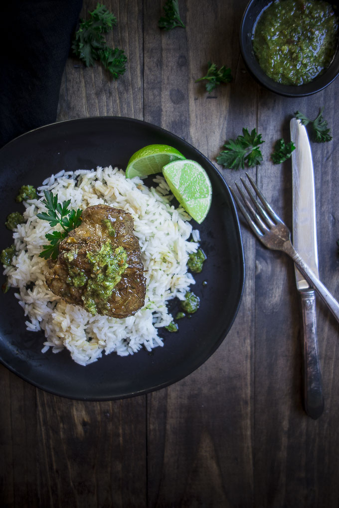 plate of instant pot short ribs ober rice with chimuchurri
