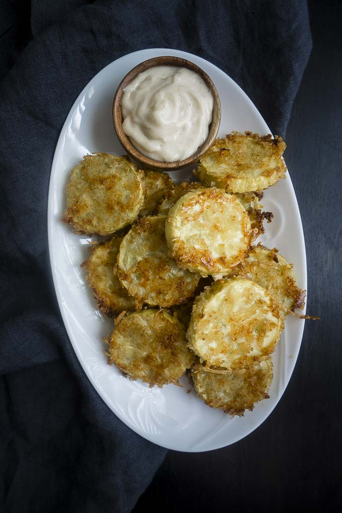 oven fried summer squash on a plate with truffle mayonnaise