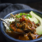 spoon full of smoky beef and poblano chili