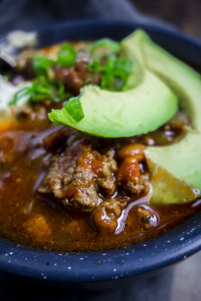 close up of instant pot beef chili with avocado