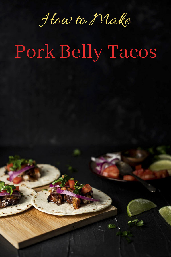 Pork Belly Tacos made with tender, juicy, crispy roasted pork belly served with fresh tomatoes, onions, cilantro, chimichurri sauce and tangy cotija cheese. Pork belly is made right in the Instant Pot and then roasted in the oven until perfectly crispy and caramelized. The fresh ingredients served with the rich, fatty pork belly makes for the most perfect pork tacos ever! #wenthere8this #porkbellytacos #roastedporkbelly
