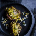 brazilian chicken on a plate with citrus corn gravy