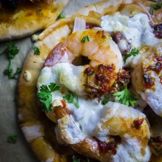 brazilian pizza with red pepper chimichurri sauce close up shrimp