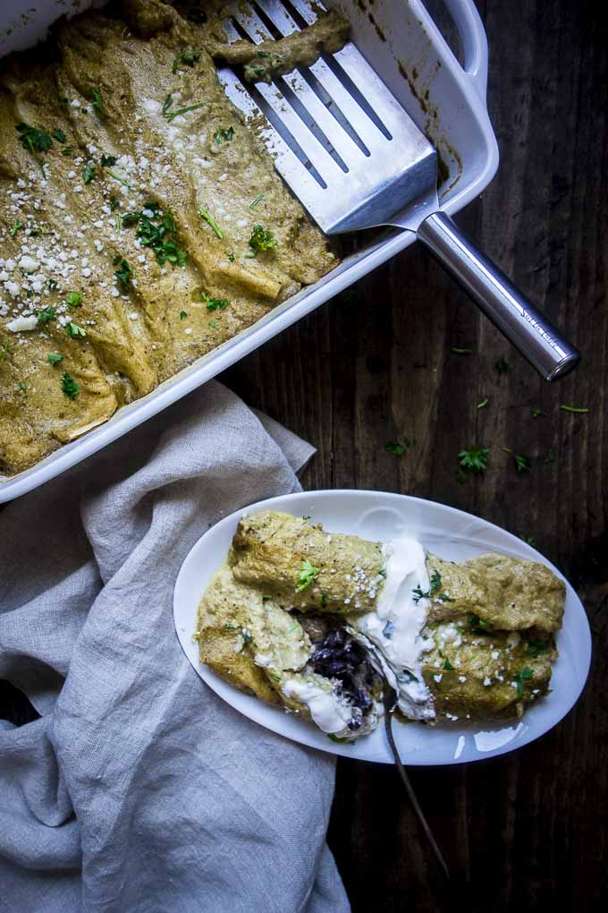 brazilian pulled pork enchiladas on a plate and in a pan with spatula