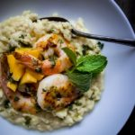 shrimp risotto with mango in a bowl with chimichurri sauce