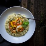bowl of coconut shrimp ristto with mango and chimichurri