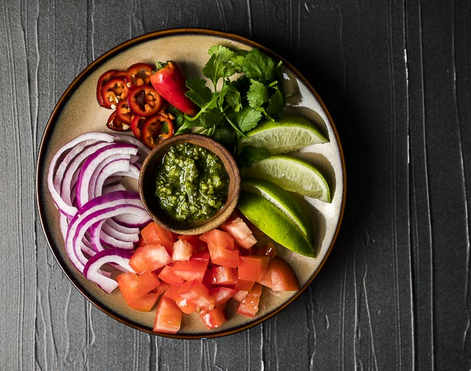 cut of veggies and salsa for tacos on a plate