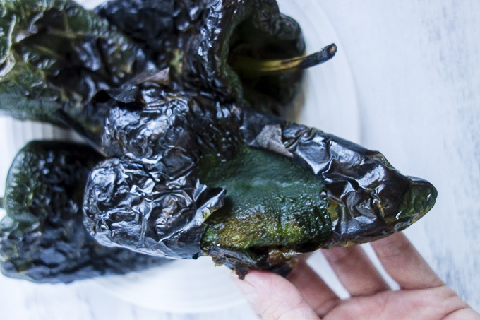 roasted poblano peppers in hand