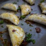 close up of baked bean and cheese empanada