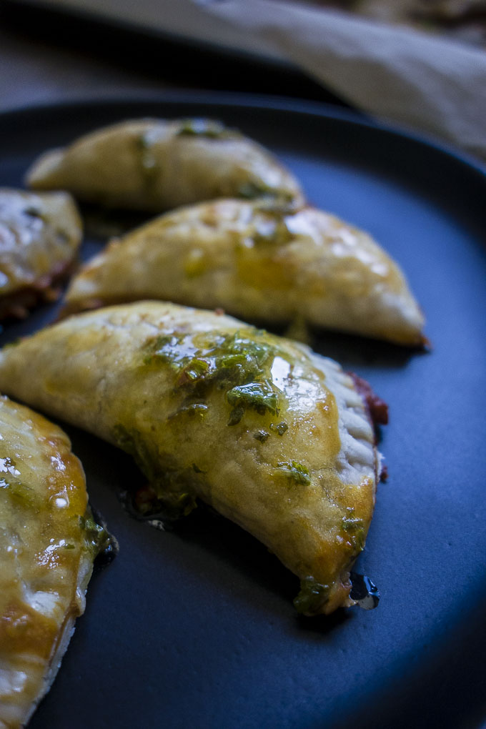 vegetarian empanadas with chimichurri on a plate