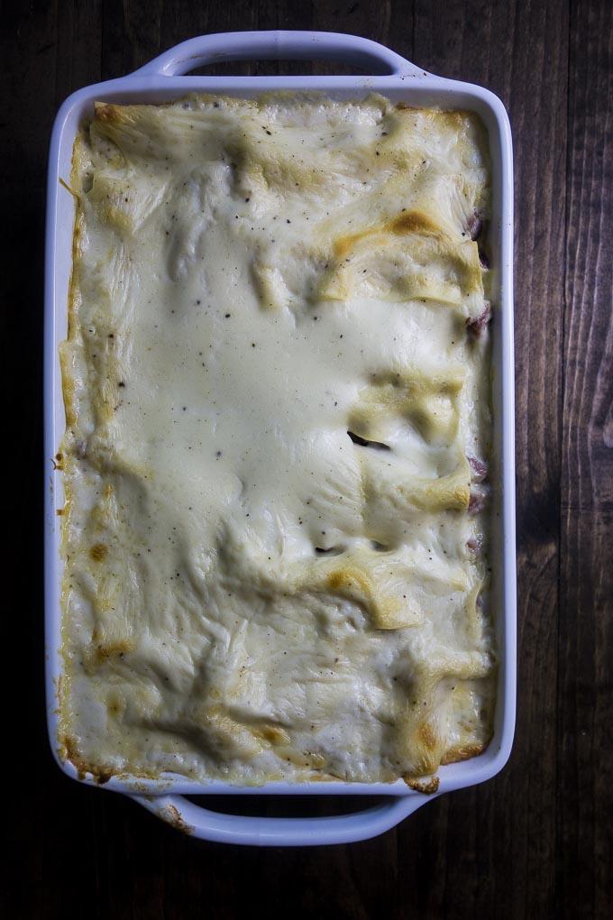 baked bechamel lasagna in pan