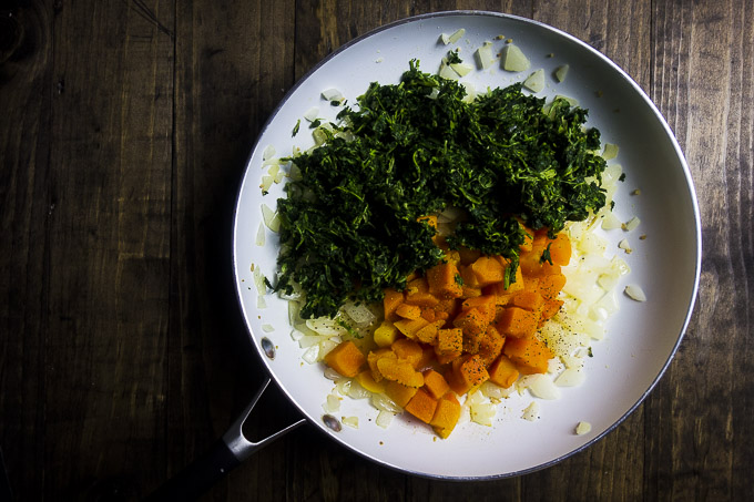 butternut squash and spinach in a skillet