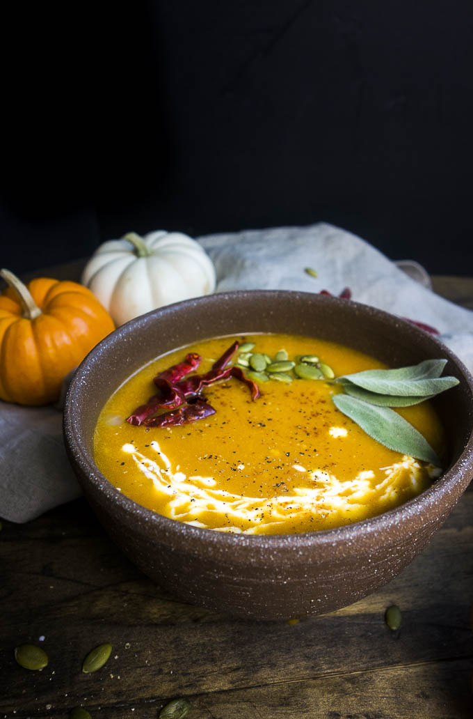 coconut curry pumpkin soup in a bowl garnished