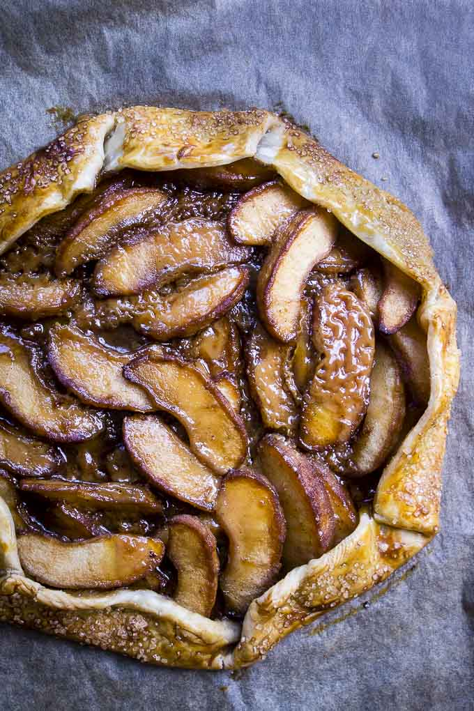 easy salted caramel apple galette on parchment paper