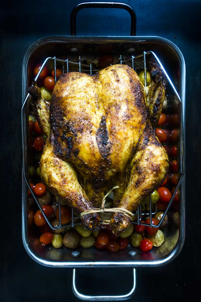 the perfect roasted chicken with tomatoes and potatoes