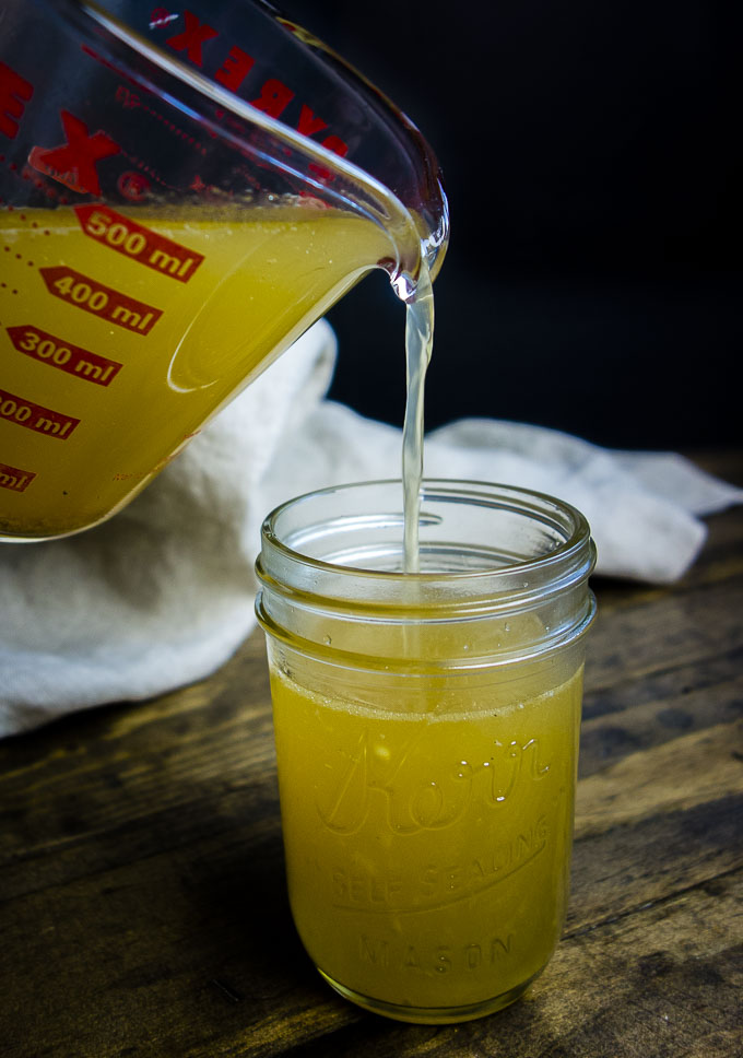 a pour shot of turkey bone broth food photography