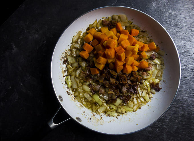 ingredients for butternut squash stuffing in a skillet