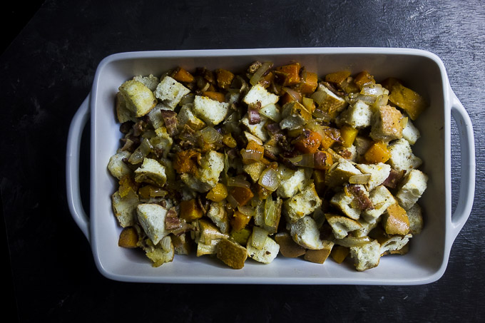 uncooked butternut squash stuffing in baking dish