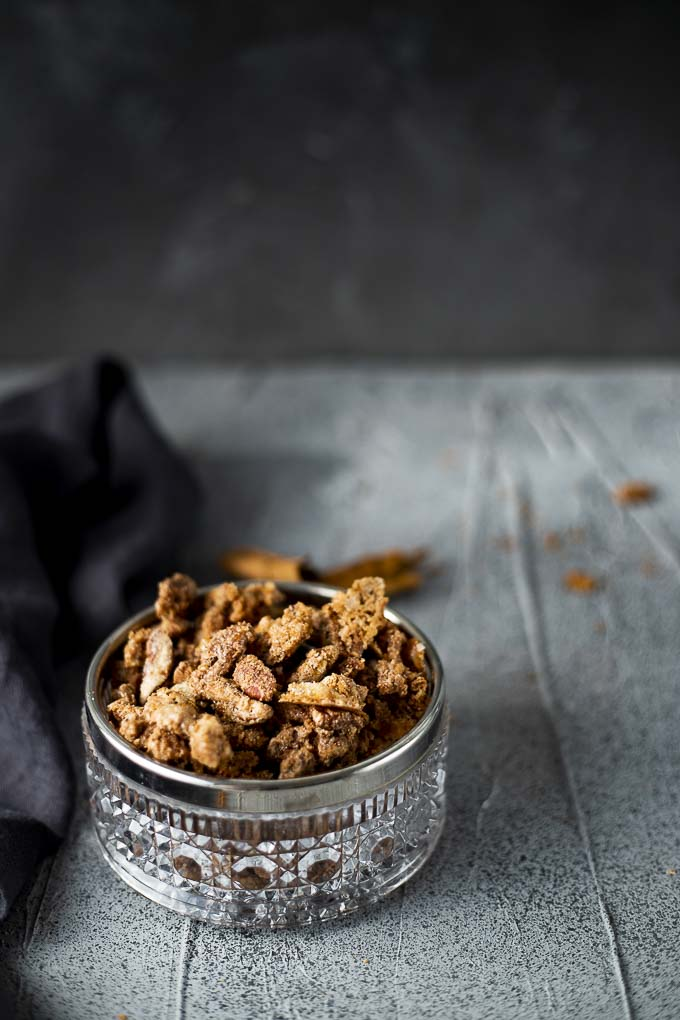glass bowl of candied pecans